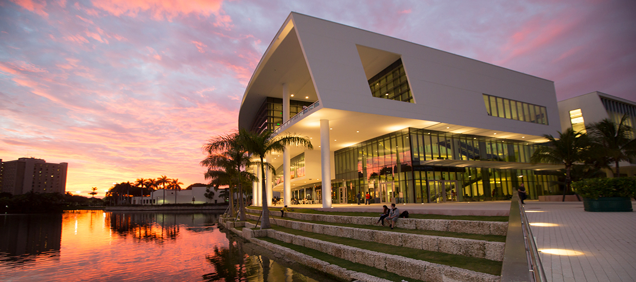 A photo of the Shalala Student Center at the University of Miami Coral Gables campus during sunset.